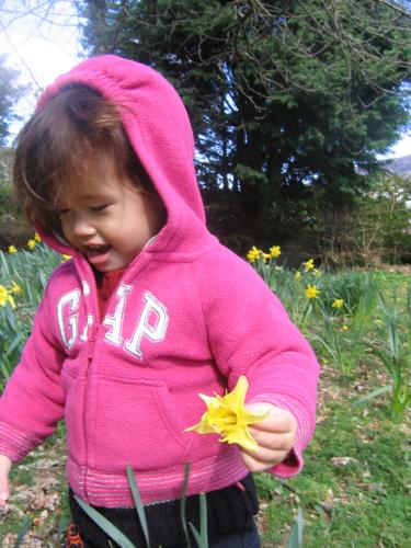 Claire in Great Uncle Michael's garden in the Scottish Highlands